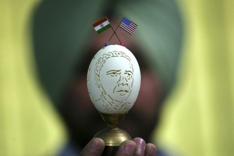 Indian artist Harwinder Singh Gill shows off his creation, an image of US president Barack Obama carved on a duck's egg shell with the national flags of India and the United States, on January 24, 2015. Mr Obama is due to arrive in India on January 25, 2015.  Munish Sharma/Reuters