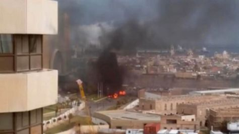 Jan. 27, 2015:  In this image made from video posted by a Libyan blogger, the Cortinthia Hotel is seen under attack in Tripoli. (AP)
