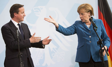 David Cameron and Angela Merkel and British Prime Minister address a press conference in Berlin on 7 June 2012.  Photograph: Carsten Koall/AFP/Getty Images