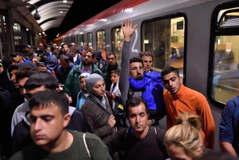 Refugees arrive at the main station in Saalfeld, eastern Germany, on 5 September by train from Austria. Photo: AFP
