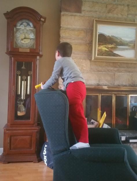 Aubren watching the clock strike.