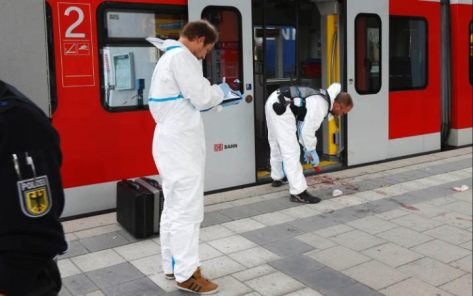 Police investigate the scene of a stabbing at a station in Grafing near Munich.  CREDIT: REUTERS
