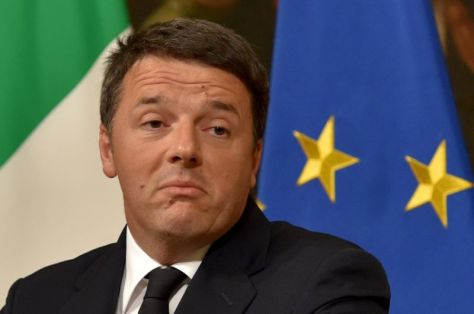 Italy's Prime Minister Matteo Renzi resigned from office December 7, 2016 (AFP Photo/Andreas Solaro)