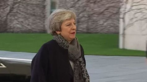 Prime Minister Theresa May arrived outside the chancellery earlier than scheduled with the German chancellor nowhere to be seen to welcome her.